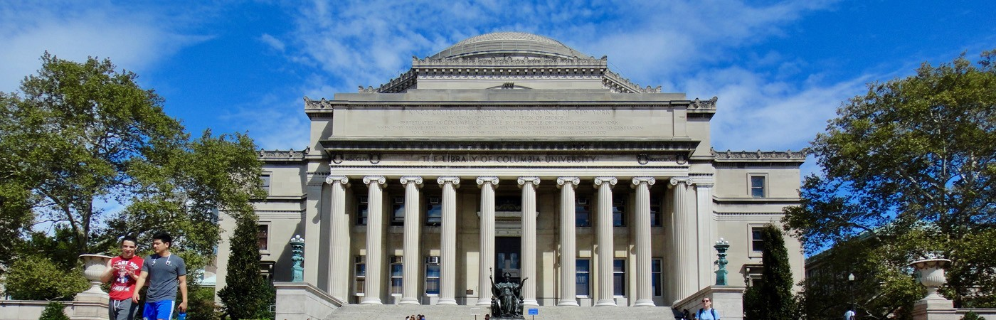Students walk in front of Low Memorial Library at Columbia University